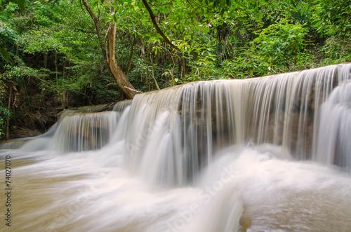 Plakat Waterfall in deep rain forest jungle (Huay Mae Kamin Waterfall i