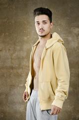 Latino man posing on wall