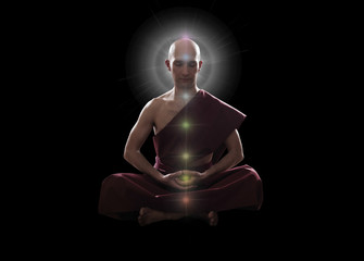 buddhist monk in meditation  pose with colorful Chakras over bla