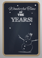 chalk board with woodframe and hand drawn snowman