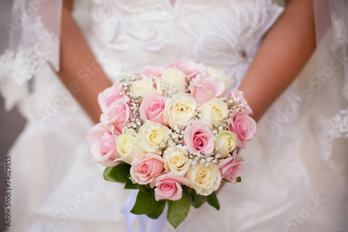 Deurstickers Roses White and pink wedding bouquet with roses in bride's hands