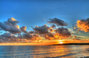 colorful sunset in Alghero coastline, Italy