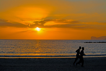 two men running at sunset