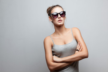 Trendy girl in sunglasses and casual clothes