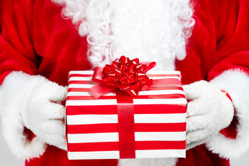 Hands of Santa Claus with gift