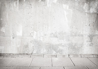 Grey concrete wall texture with walkway.