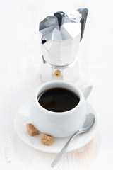 cup of black coffee and coffeemaker