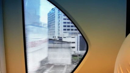 Thailand, Bangkok, 1 August 2014. Looking out the window of a