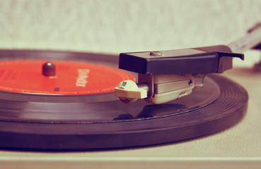 close up image of old record player, image is retro filtered . s