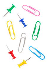 pushpin and paper clip on white