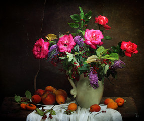 Still-life with a bouquet from roses and ripe apricots