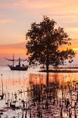 Sunset on the beach at Bangsaphan , Thailand