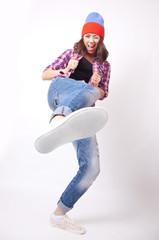 Teenage girl in torn jeans