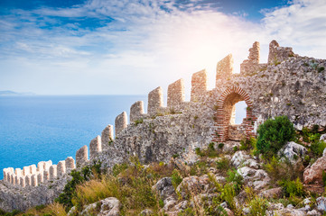 The wall of an ancient fortress on the hill in Alanya, Turkey