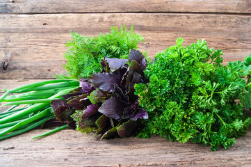 Fresh green vegetables on a wooden background