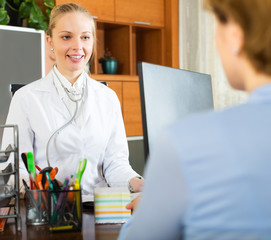 Woman having appointment of therapist