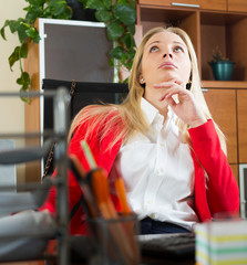 Bored businesswoman in red dreaming