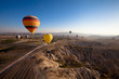 Leinwanddruck Bild - inspiring beautiful landscape with hot air balloons