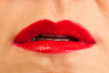 open female lips with applied red lipstick