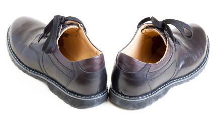 pair of men's black leather black shoes