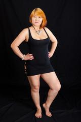 portrait of young blonde fat woman wearing a short black dress