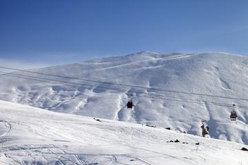 Gondola lifts and ski slope at nice sun day