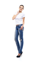 Young and beautiful teenage girl in denim jeans