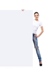 Teenage girl in denim jeans holding a blank banner
