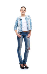 Young and beautiful teenage girl in denim jeans isolated on whit