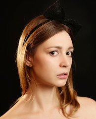 Portrait of beautiful caucasian woman on the black background