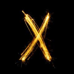 Sparkler firework light alphabet X.