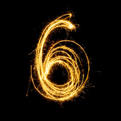 Sparkler firework light alphabet number 6.