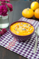 Pumpkin cream-soup with seeds in a bowl