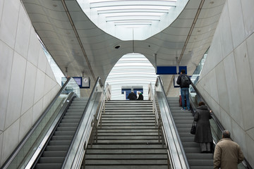 People standing on escalator