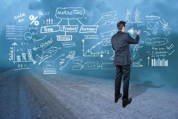 Businessman writing diagrams