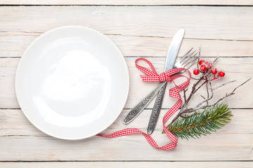 Empty plate, silverware and christmas decor