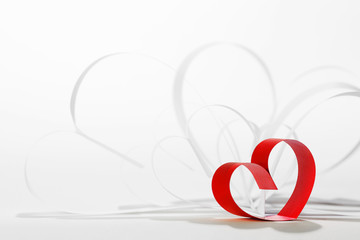 Red hearts of ribbon