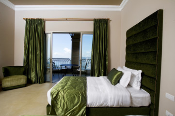 Luxurious bedroom with balcony in a five stars hotel