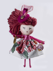 Brooch a doll on white background