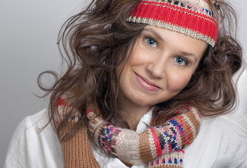Smiling girl with a knitted hat and scarf