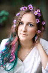 Portrait of a young woman with multicolored hair
