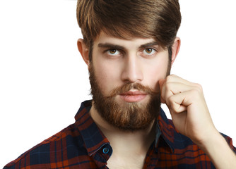 Portrait of handsome bearded young man twisting his mustache