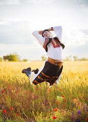 Jumping man in field