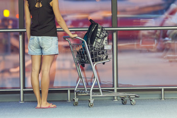 teenager with trolley in airport