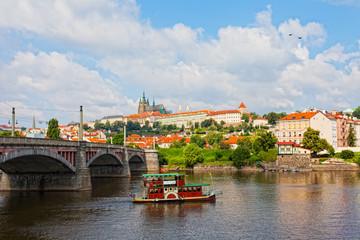 Tourist the ship floats under Charles bridge, Prague