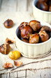 canvas print picture - roasted chestnuts in bowls