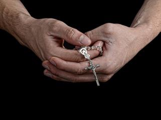 Man Holding Rosary
