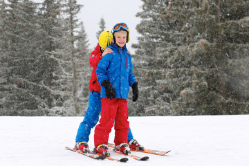 Two brothers enjoying winter ski vacation