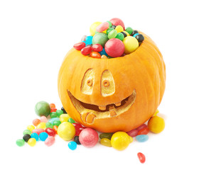 Halloween pumpkin filled with candies