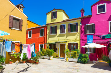 Street with colorful buildings in Burano island, Venice, Italy
